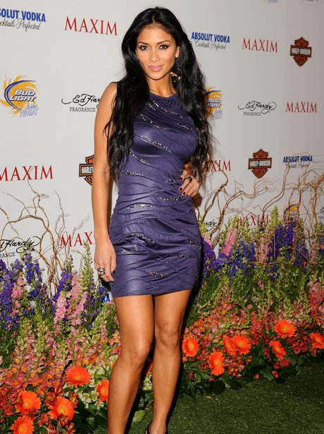 Nicole Scherzinger wearing skin tight purple dress
