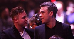 Olly Murs and Robbie Williams at the BRIT Awards