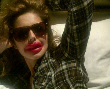 Cheryl Cole poses with fake lips for a joke about plastic surgery in LA