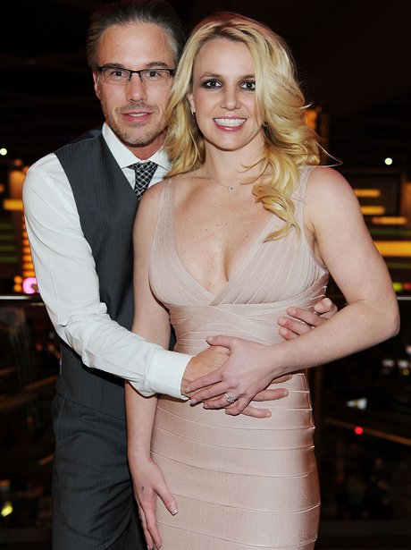 Britney Spears posing with her boyfriend and an engagement ring