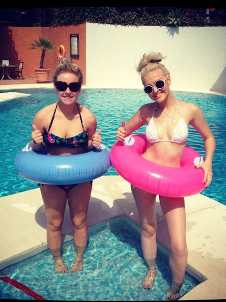 Perrie Edwards on holiday wearing a rubber ring