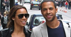 Rochelle Wiseman and Marvin Humes holding hands
