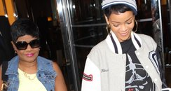 Rihanna holding hands with her mum