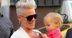 Pink's daughter Willow plays with Pink's iPhone