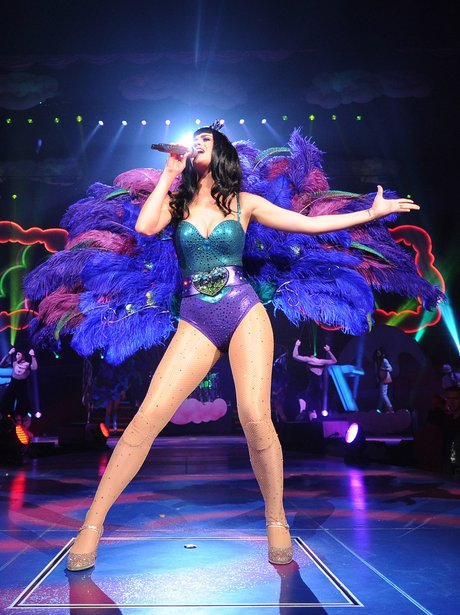 Katy Perry wearing a green and purple leotard on tour
