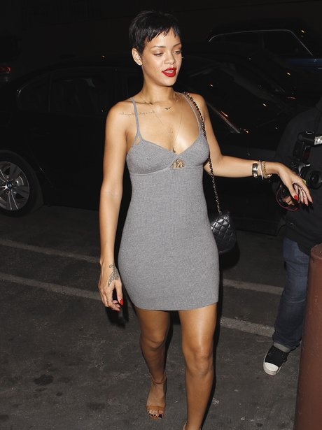 Rihanna wearing a tight grey dress in Los Angeles