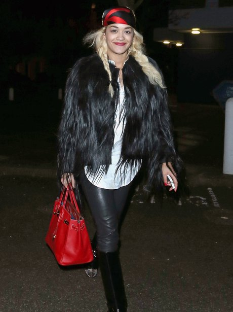 Rita Ora wearing a black fur coat in London