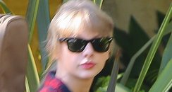 Taylro Swift heads to the studio with her guitar