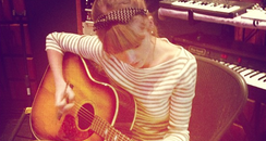 Taylor Swift in the studio with her guitar