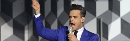 Robbie Williams live on satge at the BRIT Awards 2