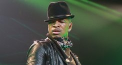 Ne-Yo performs on stage