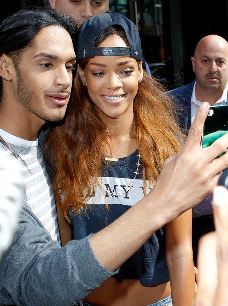 Rihanna with fans in New York