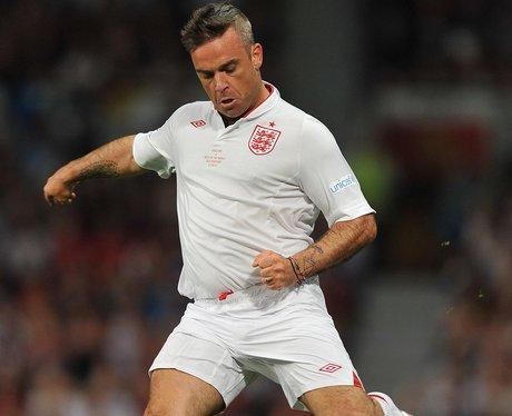 Robbie Williams playing football