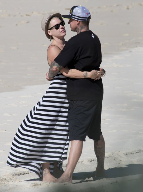 Pink and Carey Hart on the beach