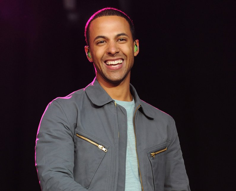 Capital FM presenter Marvin Humes takes to the stage with his JLS bandmates