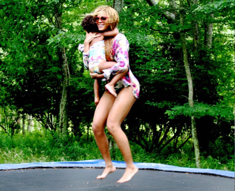 Beyone and Blue Ivy on a trampline