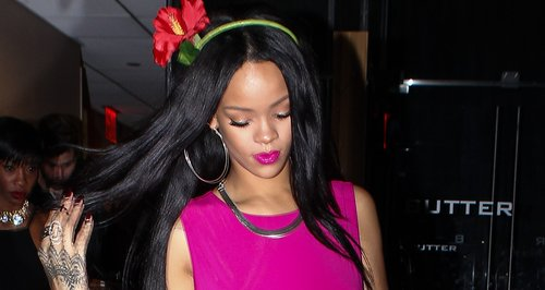 Rihanna wearing a bright pink dress