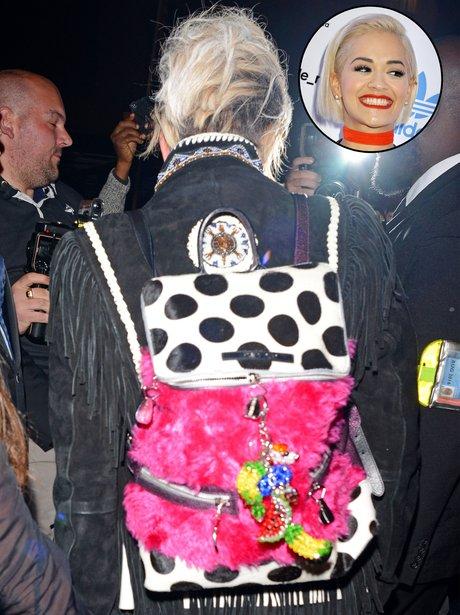 Rita Ora wearing a strange back pack