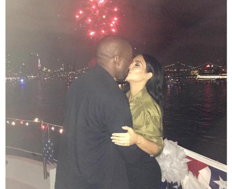 Kim Kardashian and Kanye West kiss at 4th July cel
