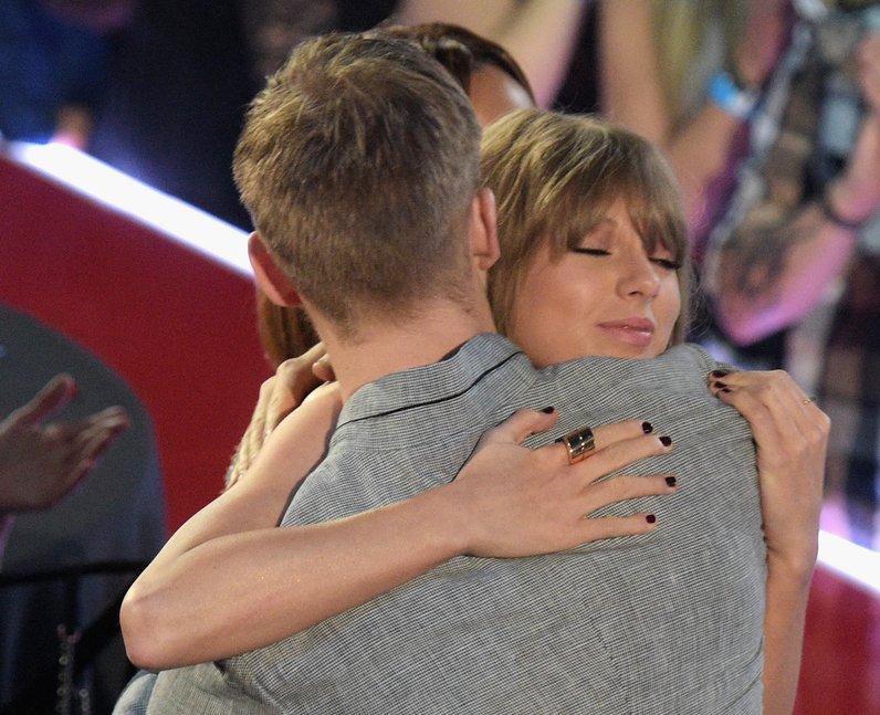 Taylor Swift hugs boyfriend, Calvin Harris at iHea
